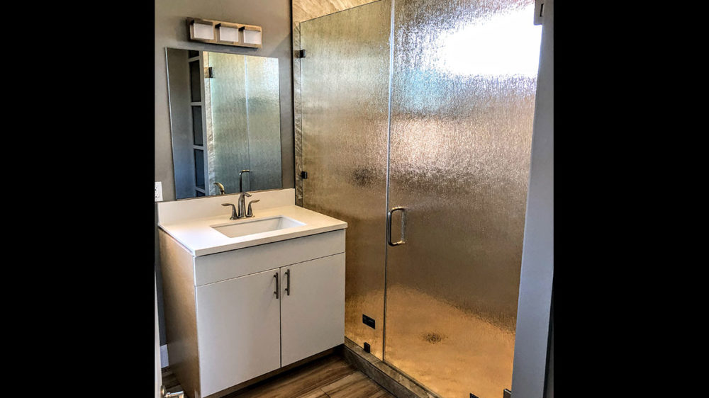 Frameless-Rain-Glass-Enclosure-with-Brushed-Nickel-Hardware–Thorp-Nakoa-St.-ADA